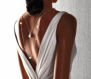 Woman wearing necklace --- Image by © Adrianna Williams /Corbis